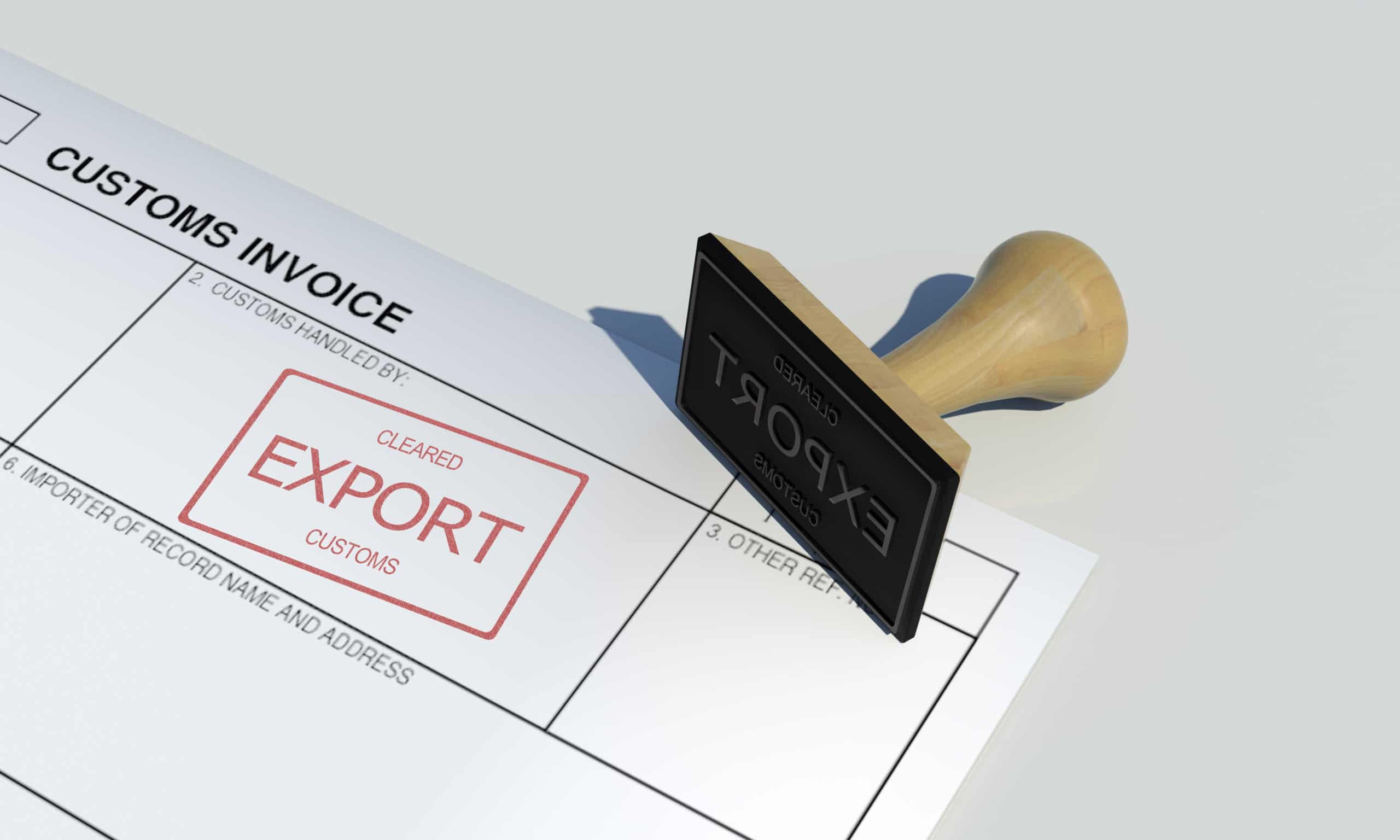 Export cleared approval stamp of customs clearance border control service on customs invoice paper with wooden stamper isolated on table surface government border protection wide scene background